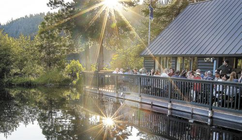 : The sun slips behind the Boathouse Restaurant at The Suttle Lodge.  ##Photo by Barbara Gonzalez