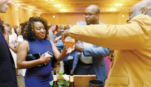 Bertony Faustin of Abbey Creek Vineyard pours his wine for guests attending TASTE PDX at the Portland Art Museum on May 31. ##Photo provided