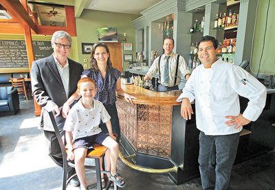 From left, restaurant owners Matthew and Katherine Otten with their son, Liam, bartender Chris Churilla and Executive Chef