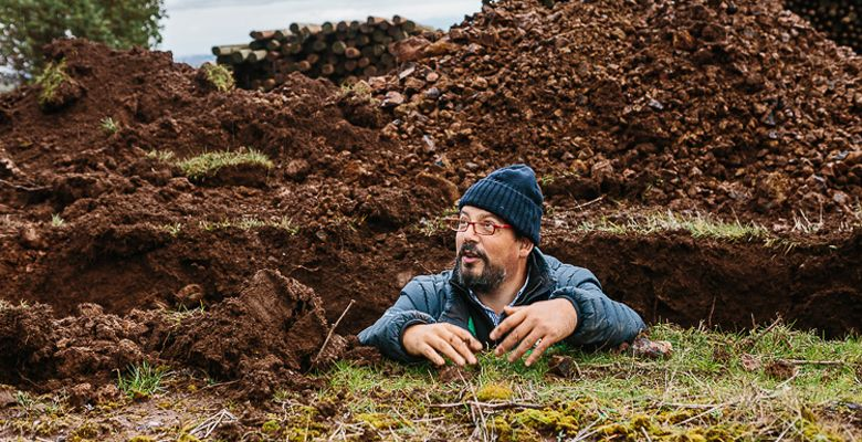 Terroir expert Pedro Parra stands in a trench, where he gathers soil samples. ##Photo by Kimberly Hasselbrink