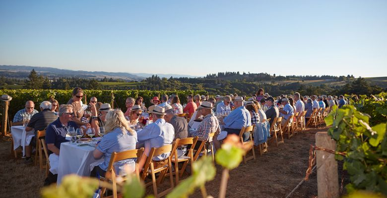 Guests enjoy a dinner in the vineyard during one of the 30th anniversary events. ##Photo by Serge Chapuis