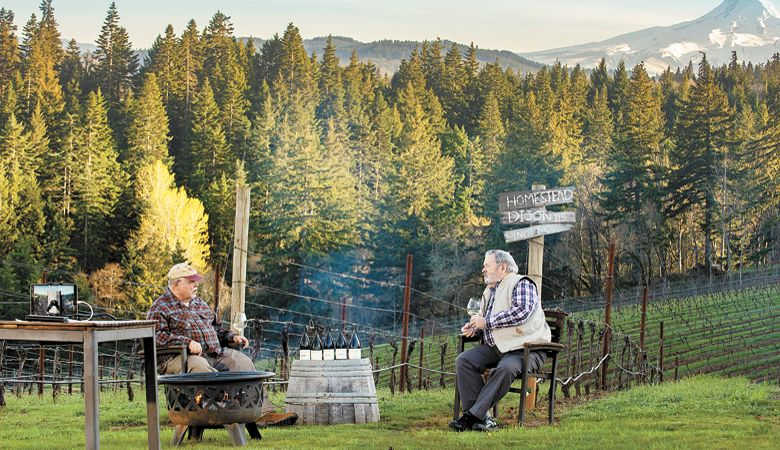 Phelps Creek Vineyard owner Bob Morus (left) and enologist Bill Swain discuss a selection of wines during a virtual tasting at the Columbia Gorge estate. ##Photo by  Kathryn Elsesser