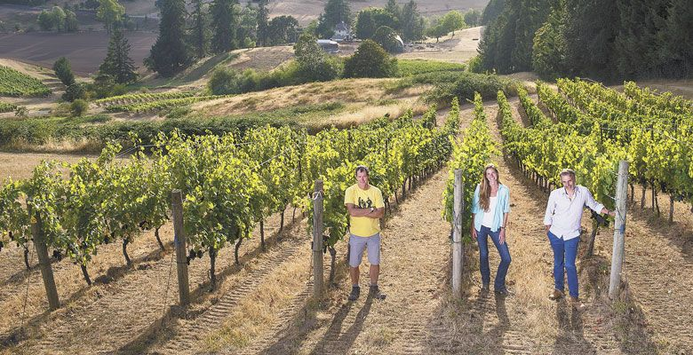 Jay Boberg (from left), Tracy Kendall and Jean-Nicolas Méo at Bishop Creek Vineyard, Domaine Nicolas-Jay's acquired property in the Yamhill-Carlton AVA. ##Photo by Andrea Johnson