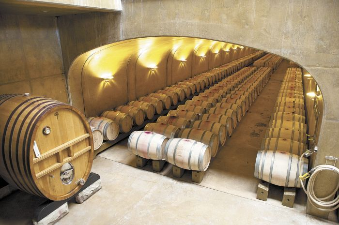 Inside the underground barrel room, Leonetti wines age for 15 to 22 months in French oak.