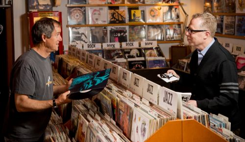 David Millman (left) and Jay Boberg chat about both music and wine industries at Jackpot Records on S.E. Hawthorne in Portland. ##Photo by Kathryn Elsesser