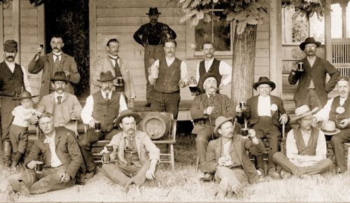 Circa 1896. Adolph Doerner (child on left/middle row) leaning on father Adam Doerner, next to Adam's brother, Henry Doerner. In the back (from left): John Von Pessl (holding wine), next to Edward Von Pessl (holding mug). ##Photo courtesy the Doerner Family and the Linfield Archives
