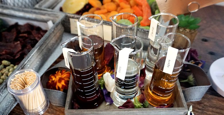 Spring s table of taste identifiers, including flasks of bitters, helps guests recognize some of the flavors and aromas in the wines. ##Photo by Viki Eierdam