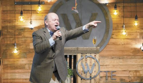 Auctioneer Fritz Hatton playfully prods the audience for higher bids at this year's Willamette: The Pinot Noir Auction. ##Photo by John Valls
