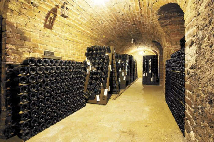 Sparkling fills an old wine cave at a Champagne house in Épernay, France. Stock photo.