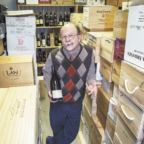 Tom Reider, longtime wine manager at Wizer's in downtown Lake Oswego, stands among the market's international cellar located in the basement.