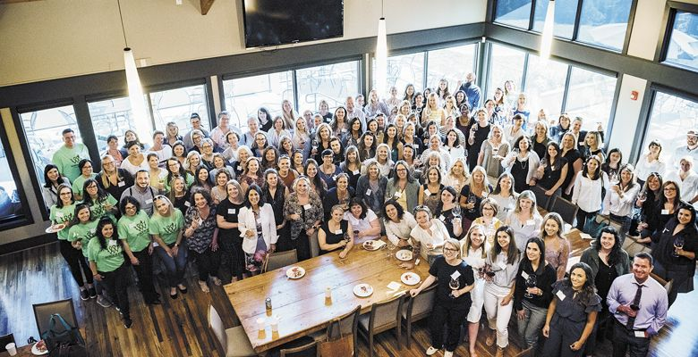 Women in Wine: Fermenting Change seminar. Guests, workers and speakers pause for a group shot inside Willamette Valley Vineyards' tasting room. ##Photo by Kathryn Elsesser