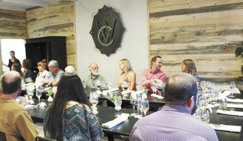 A group gathers for a multi-course dinner paired with Wooldridge Creek wines on Sept. 8 at Vinfarm. ##Photo by Maureen Battistella