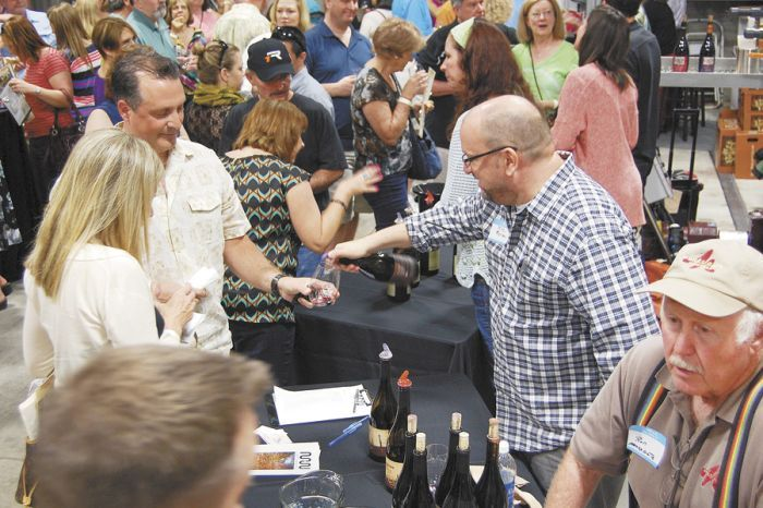 Mike Merriman, of Merriman Wines, pours samples for eager tasters at the Yamhill Carlton tasting hosted at Anne Amie. Photo by Hilary Berg.