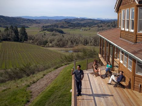 Guests soak up the sun on Youngberg Hill Inn's new deck. Located near McMinnville, the inn boasts some of the best views in the entire Willamette Valley. Owners Wayne and Nicolette Bailey also make wine by the same name. Photo provided.
