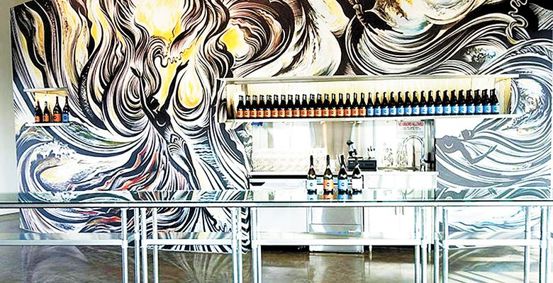 The original mural, by Ohio artist Cathie Bleck, at the Chapter 24 Vineyards tasting room in Dundee was inspired by the Missoula Floods.##Photo Provided
