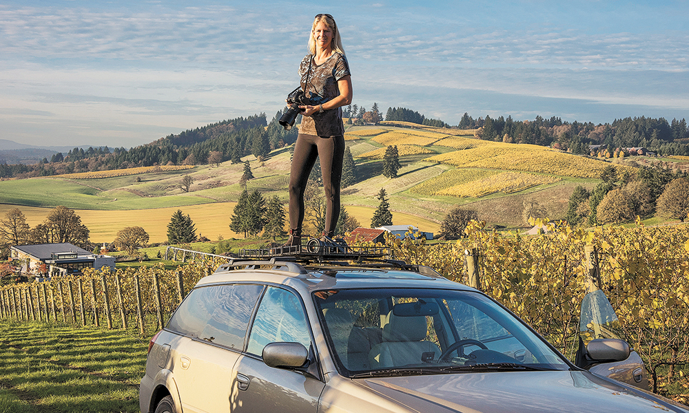 Johnson stands on her rooftop Subaru platform overlooking Saffron Fields Vineyard and WillaKenzie Estate, located outside Yamhill. ##Photo by Robert Holmes